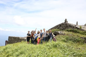 Teachers and staff pose for a picture together at the top of Wugong Mountain, 2015